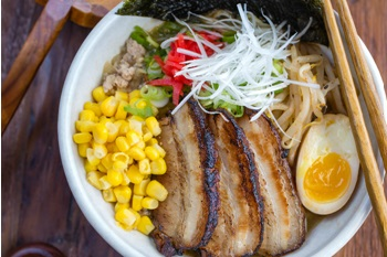 put chashu, ramen egg, spicy bean sprout salad, corn, scal..