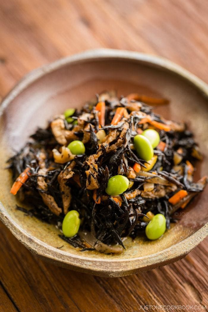 Healthy hijiki seaweed salad cooked in a savory sauce with edamame ...