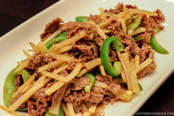 Chinese Pepper Steak with green bell pepper and potato on a plate.
