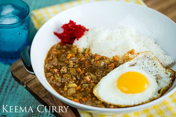 Keema Curry with white rice topped with egg.