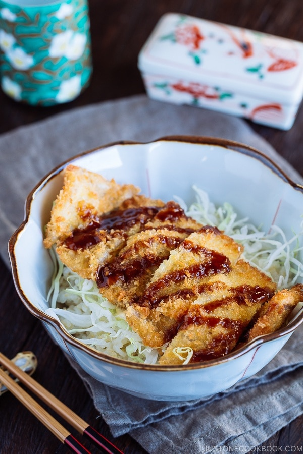 Crispy Tonkatsu over bed of rice and shredded cabbage.
