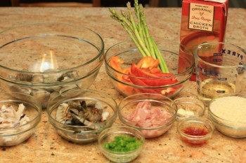 Paella ingredients on top of a granite countertop