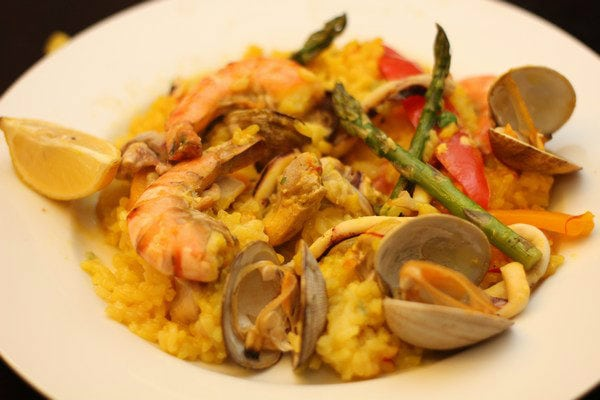 Paella on a white plate.