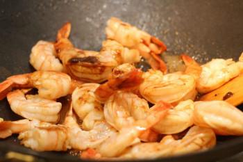 shrimp stir fry in a metal pan