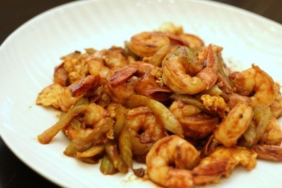 Shrimp and Celery with Ketchup Tobanjiang Sauce on a white plate.