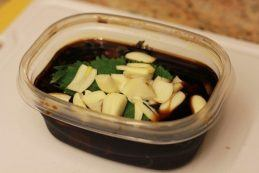 Shiso Garlic Soy Sauce in a plastic container.