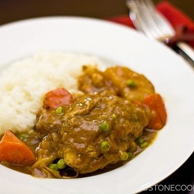 Chicken Curry with white rice on a plate.