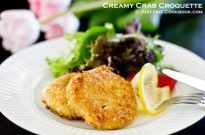 Creamy Crab Croquette and salad on a plate.