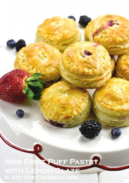Mini Fruit Puff Pastry with berries on a cake stand.