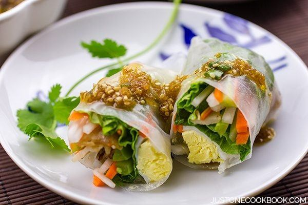 Spring Rolls with Sesame Ponzu Vinaigrette on a plate.