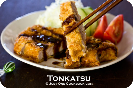 Tonkatsu and salad on a plate.