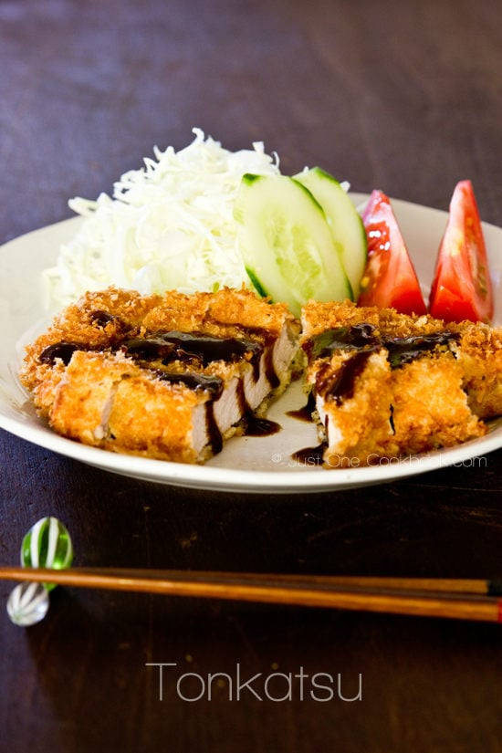 Tonkatsu and salad on a white plate.