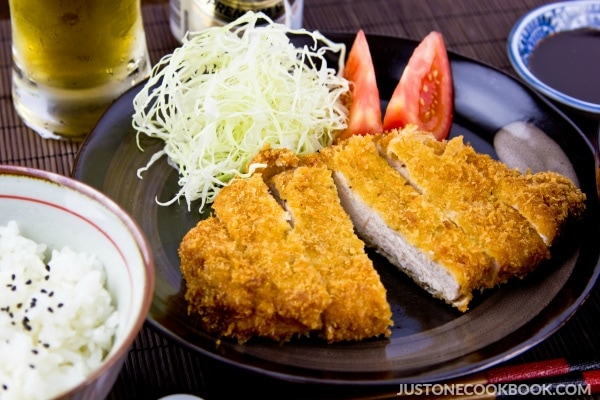 Tonkatsu, salad, rice, and a glass of drink.