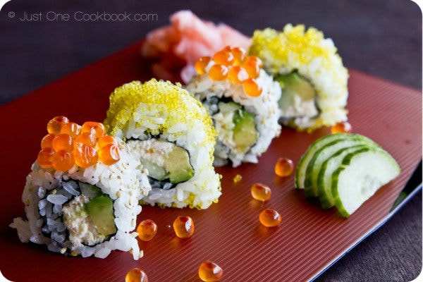 California Roll on a red plate.