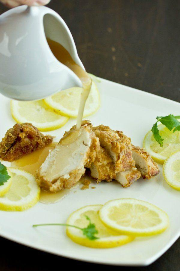 Lemon Chicken with lemon glaze on a plate.