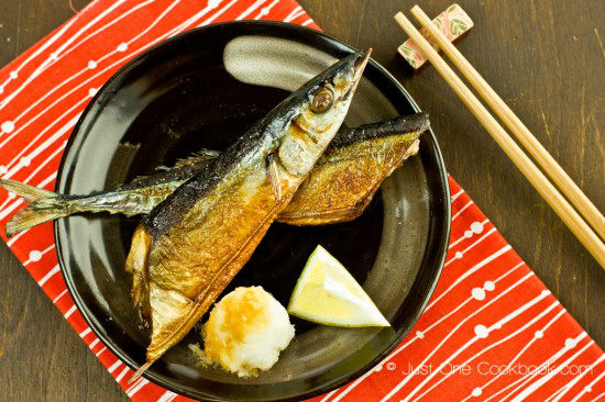 Sanma Shioyaki with daikon radish on a plate.