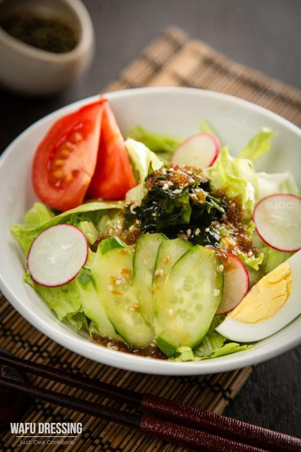 Salad with Wafu Dressing in a white bowl.