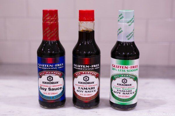 Bottles of gluten free soy sauce on the table.
