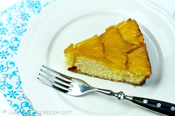 Pineapple Upside Down Cake on a plate with fork.
