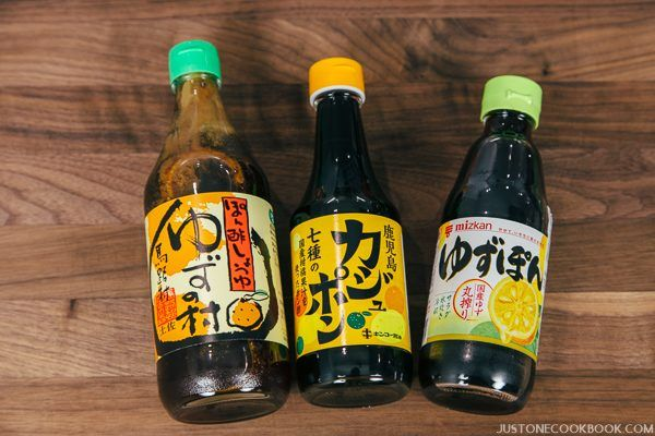 Three type of Ponzu sauce bottles on the wooden table.