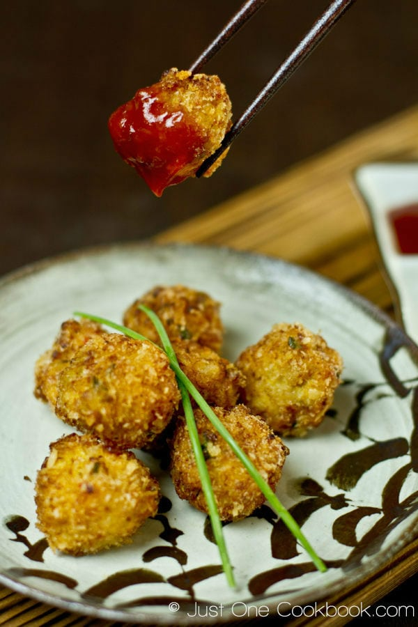Deep Fried Shrimp Ball covered with ketchup.