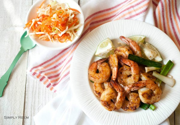 Honey Glazed Shrimps and Asian coleslaw on a plate.