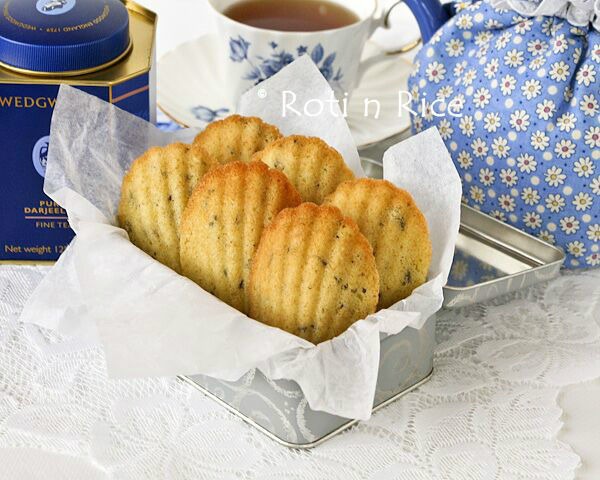 Lavender Madeleines in a box and a cup of tea.