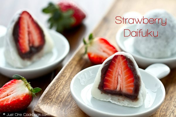 Strawberry Daifuku on white dishes.