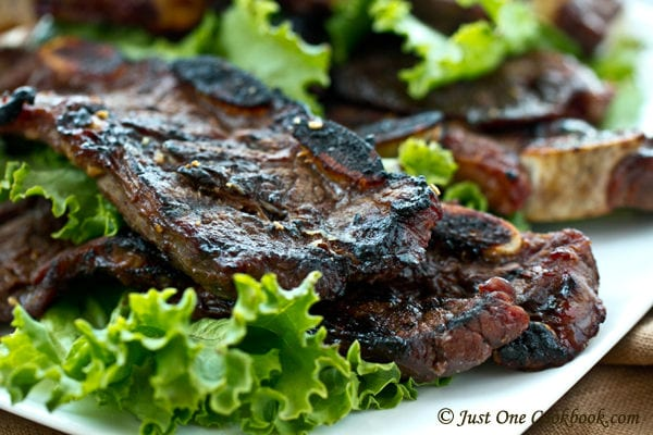 BBQ Beef Short Ribs with greens on a plate.
