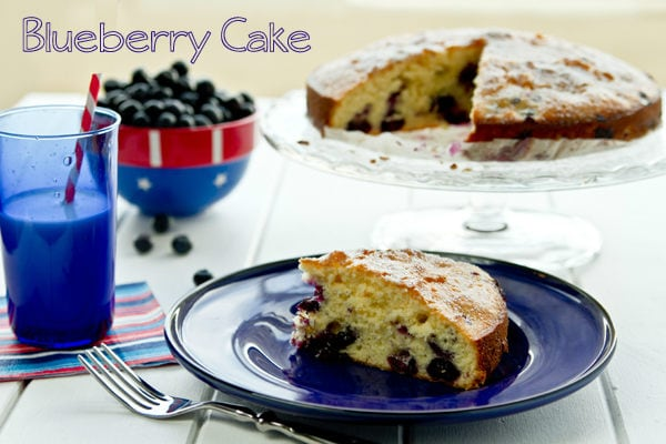 Blueberry Cake on a plate and cake stand.