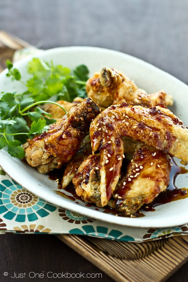 Nagoya Style Fried Chicken Wings coated with savory sweet garlic soy dressing on a white plate.