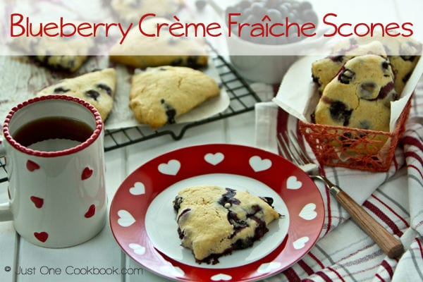 Blueberry Crème Fraîche Scones on a plate and a cup of coffee.