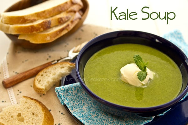 Kale Soup and bread on a table.