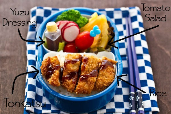 Tonkatsu Bento on a wooden table.
