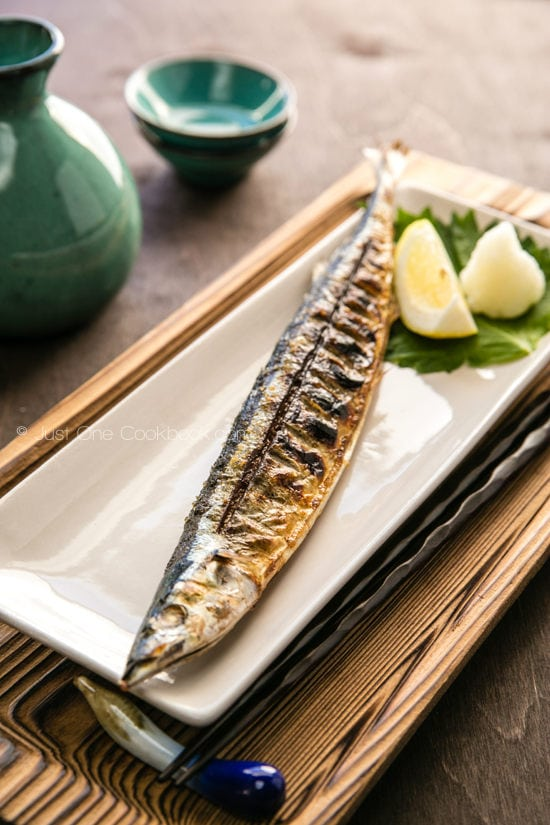 Grilled Sanma on a white dish.