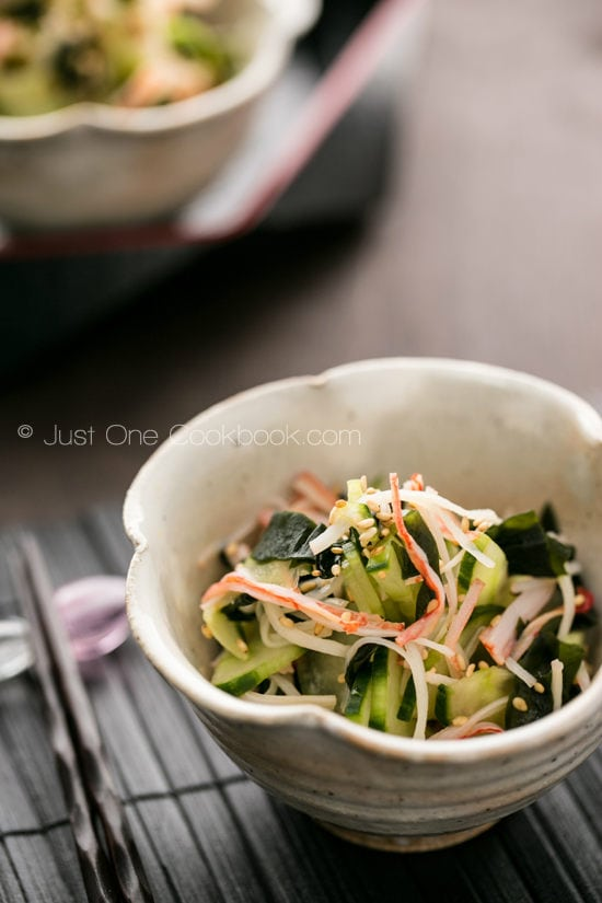 Japanese Cucumber Salad with wakame and imitation crab in a bowl.