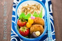 Korokke Bento with rice, tomatoes and fruit.