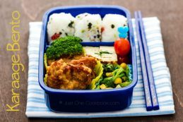 Karaage Bento with tamagoyaki, broccoli, tomato, spinach sautee, and Onigiri.