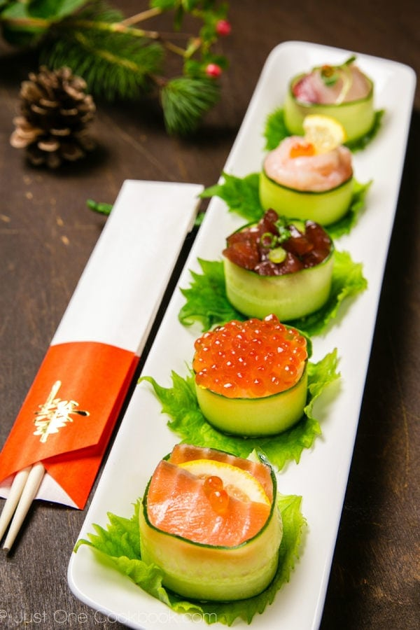 Cucumber Wrapped Sushi on a white long plate.