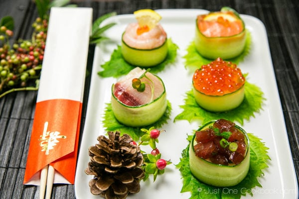 Cucumber Wrapped Sushi on a white plate.