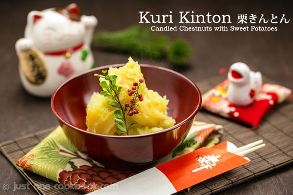 Kuri Kinton, Candied Chestnuts with Sweet Potatoes in a red bowl and a new year decorations on a table.
