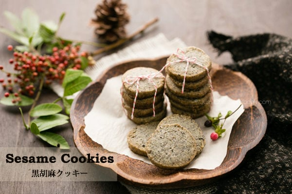 Sesame Cookies on a wooden dish.