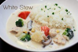 White Stew and white rice in a bowl.