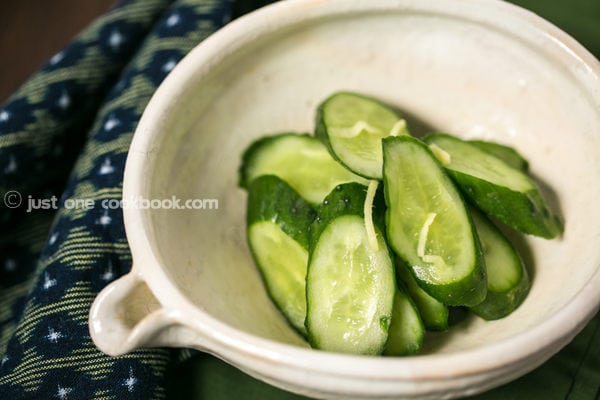 Pickled Cucumbers in a white bowl.