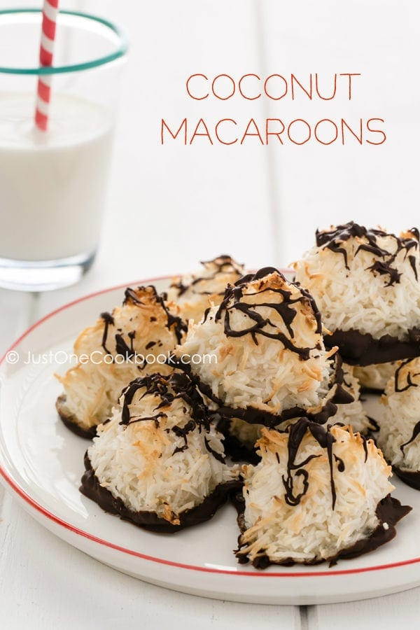Coconut Macaroons on a plate and a glass of milk.
