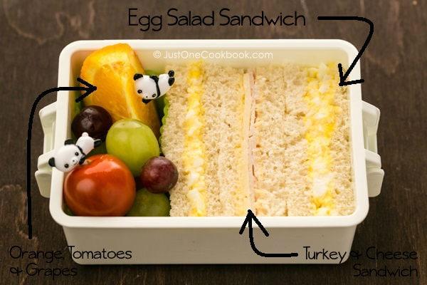 Egg Salad Sandwich Bento on a table.