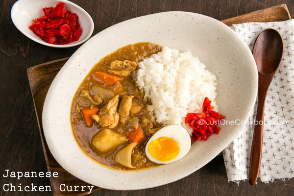 Chicken Curry with white rice on the plate.