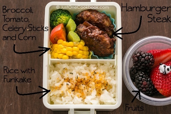 Hamburger Steak Bento On A Wooden Table
