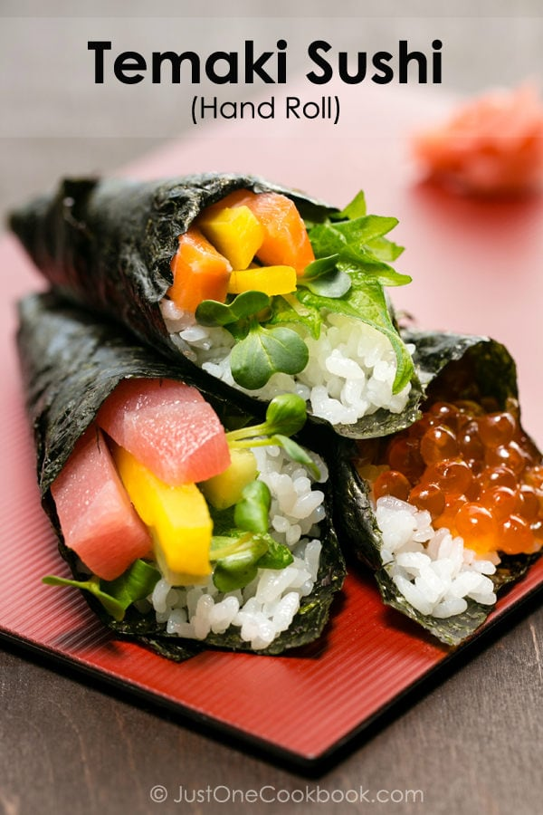 Temaki Sushi, Hand Roll on a red plate.