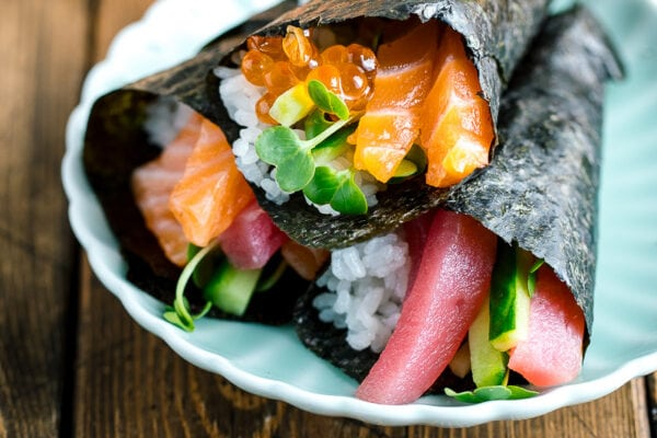 delicious hand roll temaki sushi served on a plate